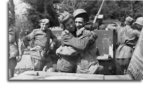American and Russian soldiers embrace on the banks of  the Elbe River, April 25, 1945