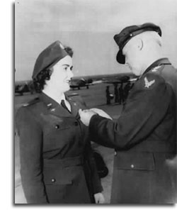 WASP Pilot Barbara Erickson Receiving a medal