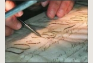 A conservator works on the Constitution.
