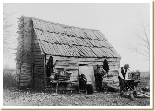 Photograph, African American Family Outside Their Cabin in Virginia, ca. 1900