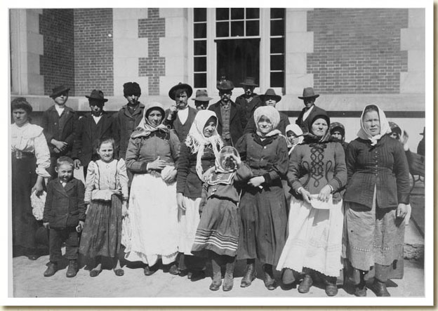 Photograph, Immigrants Outside a Building on Ellis Island, early 20th century