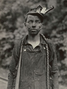�Young Driver in Mine. Has been driving one year. 7 A.M. to 5:30 P.M daily Brown Mine, Brown W. VA.� photograph and caption by Lewis Hine, 1908.