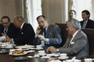 President Bush on the telephone with German Chancellor Helmut Kohl during a meeting with congressmen at the White House, photograph by David Valdez, October 3, 1990