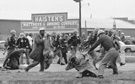 John Lewis (in the foreground) being beaten by state troopers, March 7, 1965