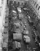 Shanties were built in a courtyard at Santo Tomas to help ease the overcrowding in the buildings, 1945