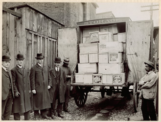 historical image of FDA inspectors and delivery truck