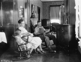 historical image of family listening to the radio