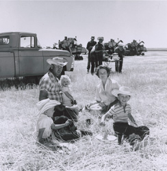 historical image of family picnicking