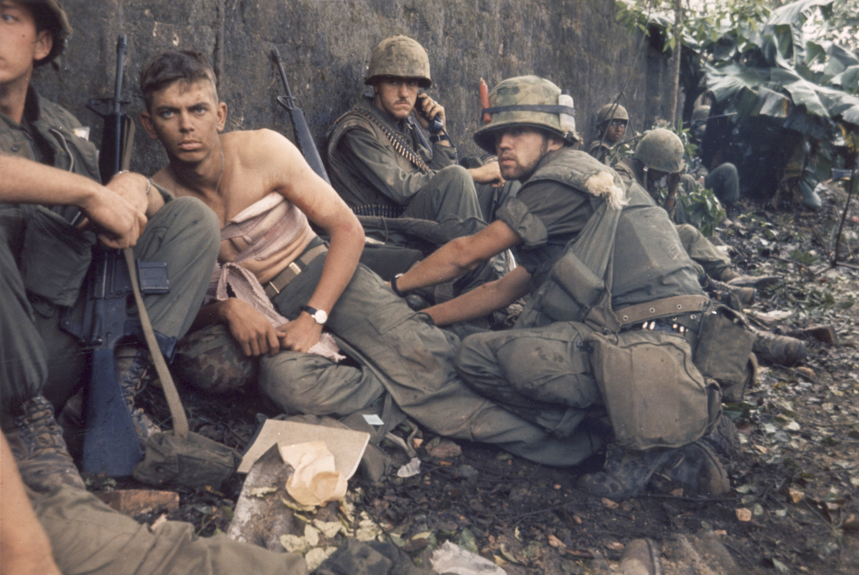 """""""Navy Hospital Corpsman D. R. Howe treats the wounds of Private First Class D A. Crum, 'H' Company 2nd Battalion, Fifth Marine Regiment during Operation Hue City"""