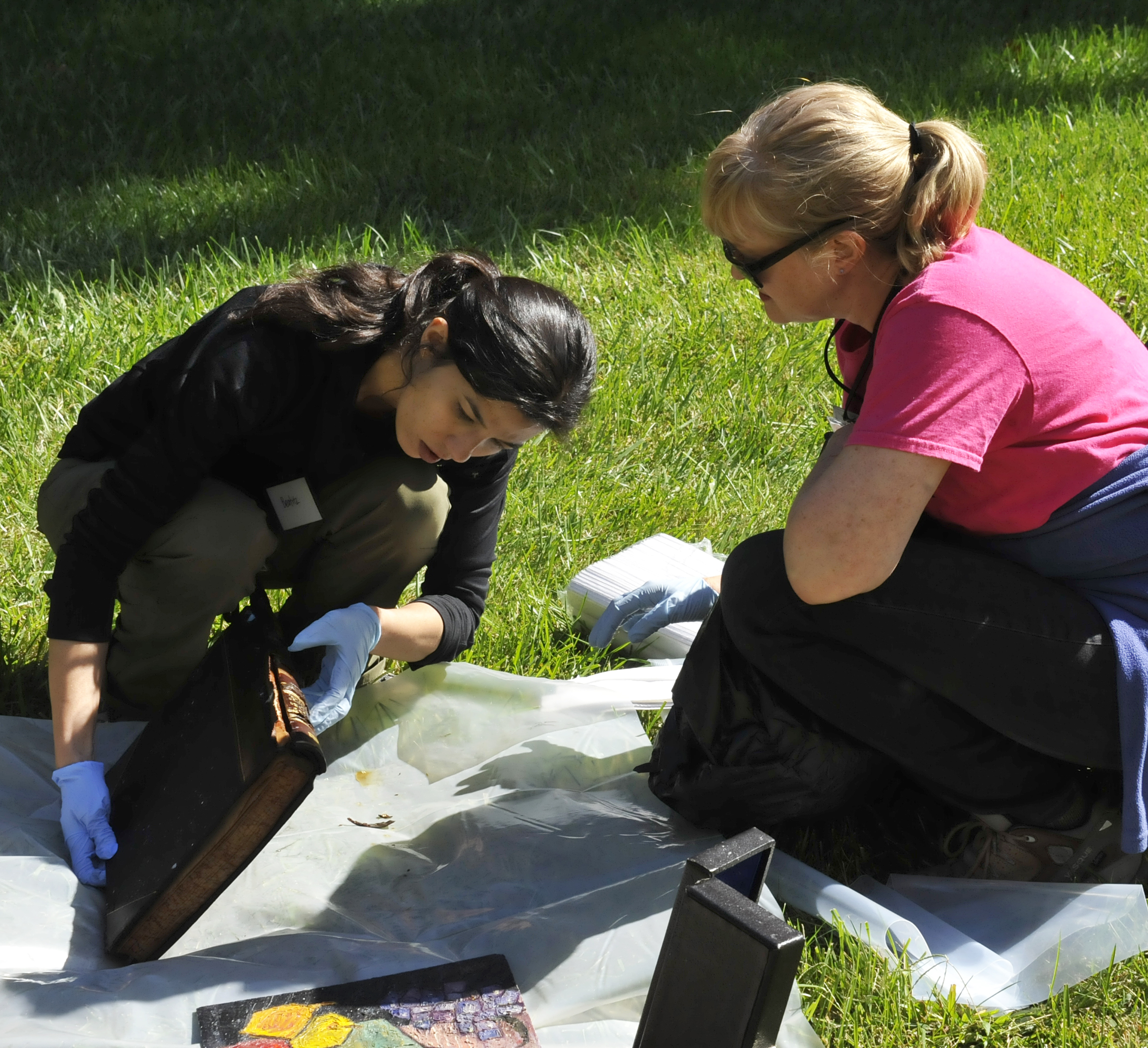 disaster recovery exercise conservator beatriz centeno left and preservation specialist pam kirschner right survey water