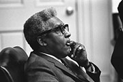 Photograph of Bayard Rustin at meeting with Lyndon Baines Johnson