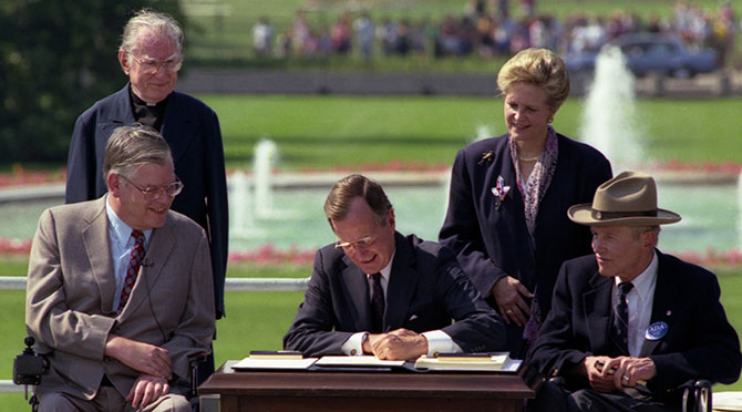President Bush signs the Americans with Disabilities Act