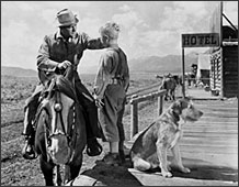 Alan Ladd and Brandon deWilde in <em>Shane.</em>