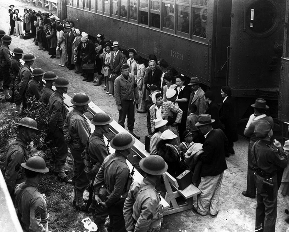a look at the japanese internment 110,000 japanese americans were held in 10 internment camps from may 1942 to  they don't look like enemies in their american clothes waiting to be sent off.