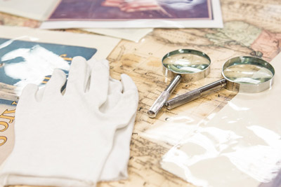 Gloves and Magnifying Glass