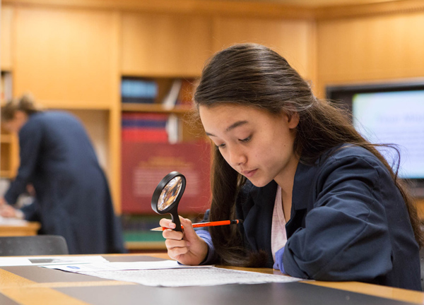 Student with Magnifying Glass and Document