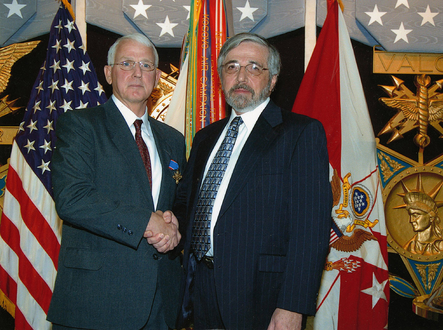 Stephen E. Lawrence (left) shakes hands with Richard Boylan, the archivist who found the order for his award, March 24, 2005 Photo courtesy of Richard Boylan