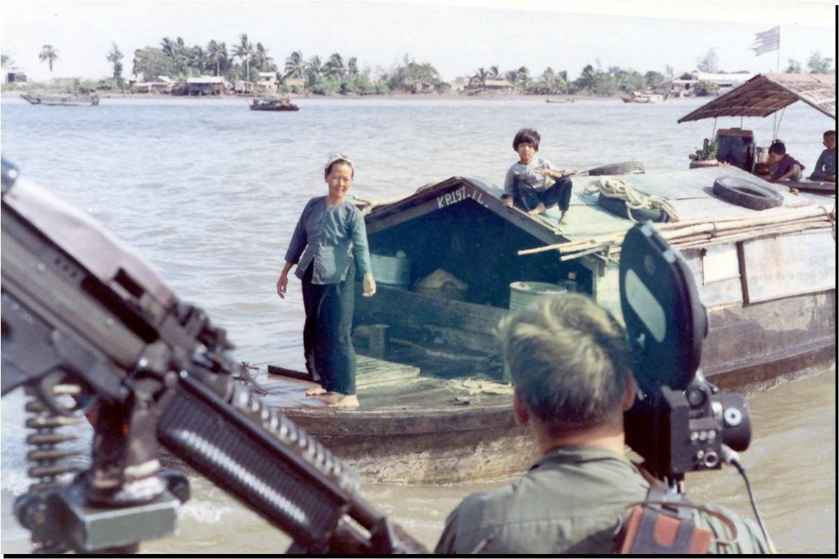 Vietnam combat motion picture photographer at work