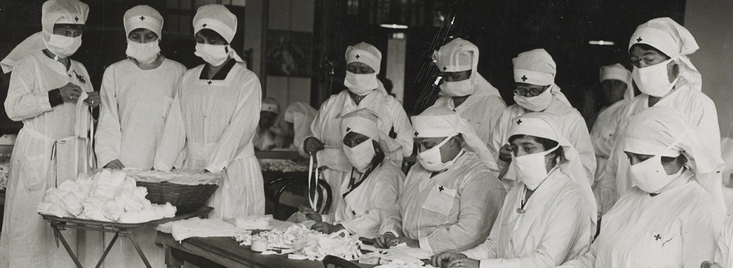 Red Cross workers make masks