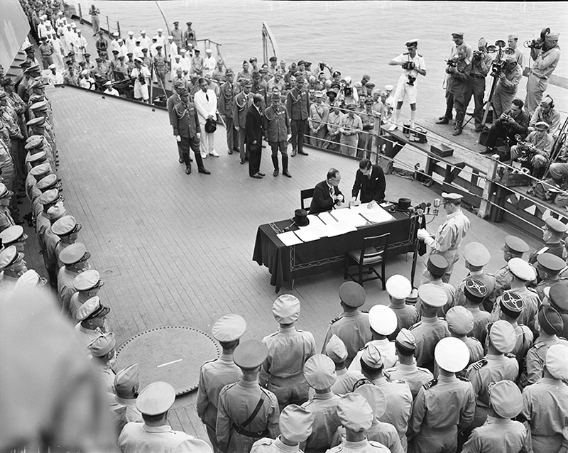 Signing surrender on USS Missouri September 1945