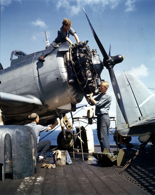 Mechanics overhaul engine of an F6F on a carrier in the Pacific