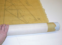 Paper is rolled onto the tube with the tube at a right angle to the long edge