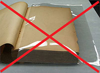 Image of what not to do, a book with a polyester sleeve on the page