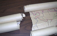 Rolled map that is torn in half