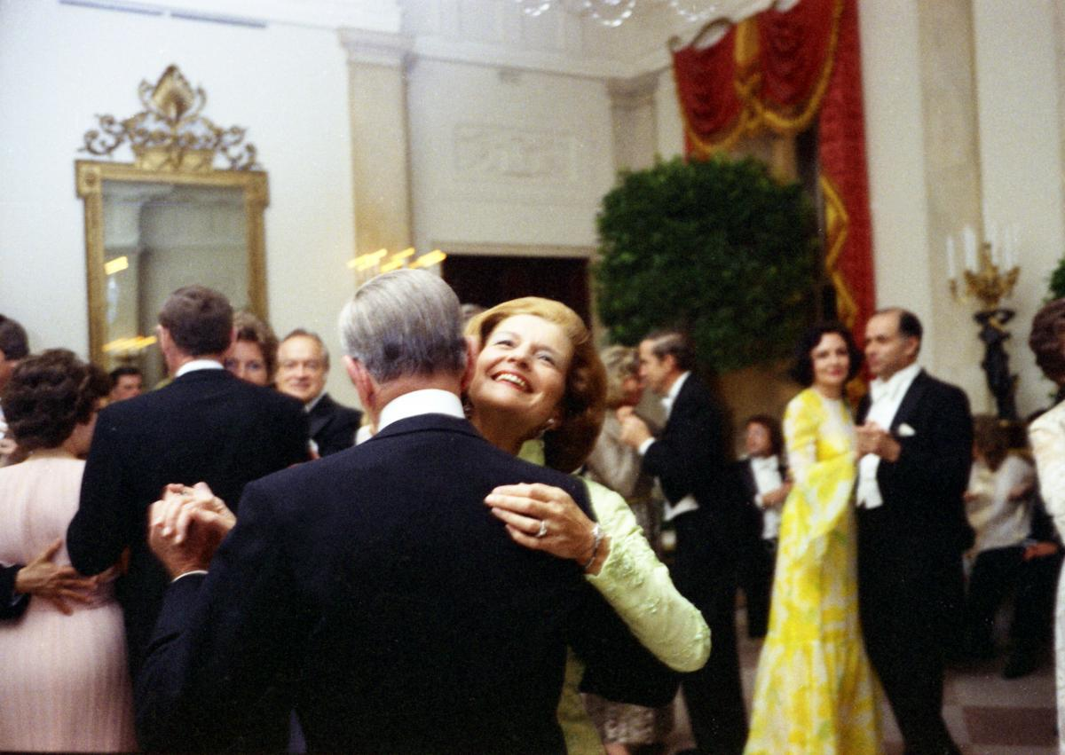 First Lady Betty Ford fulfills a lifelong dream of dancing with Fred Astaire at a state dinner honoring the Shah of Iran. May 15, 1975.