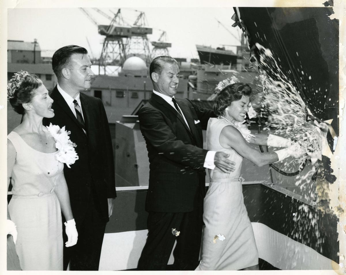 Betty Ford, the ship's sponsor, christens the USS Dace (SSN 607) at Ingalls Shipbuilding in Pascagoula, Mississippi. August 18, 1962.