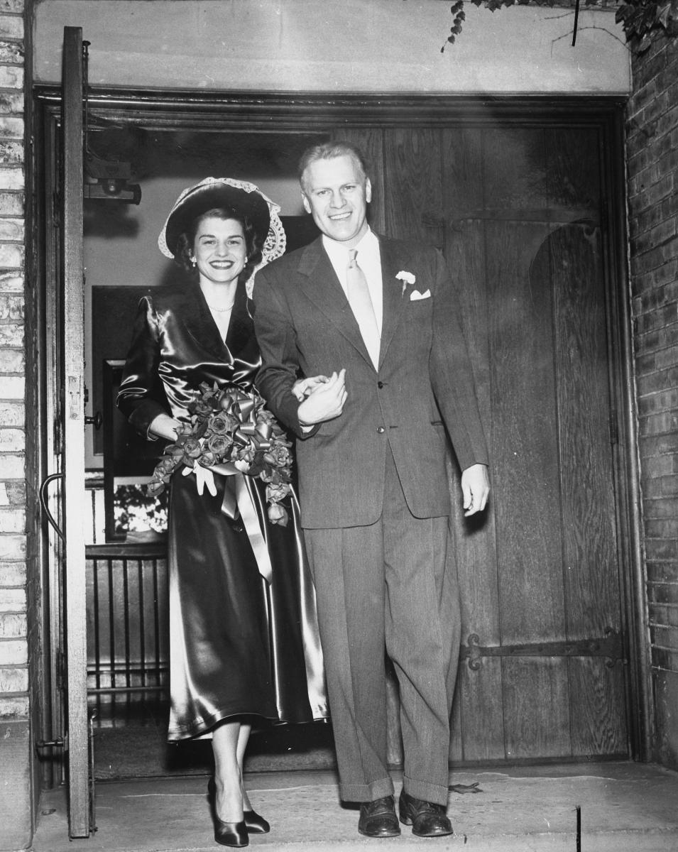Gerald and Betty Ford walk out of Grace Episcopal Church in Grand Rapids, Michigan, following their wedding. October 15, 1948.