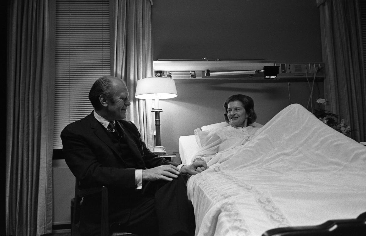 President Ford visits First Lady Betty Ford in the President's Suite at Bethesda Naval Hospital following her breast cancer surgery. October 2, 1974.