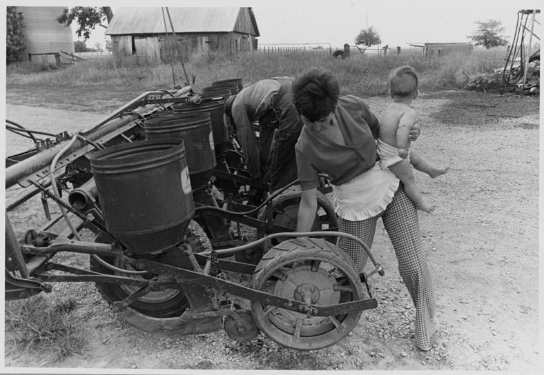 Jean Schnelle pulling weeds