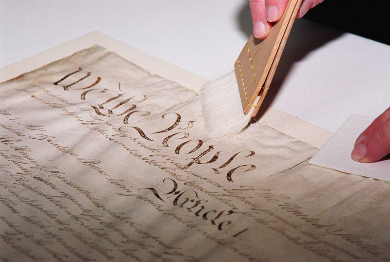 A conservator works on the U.S. Constitution