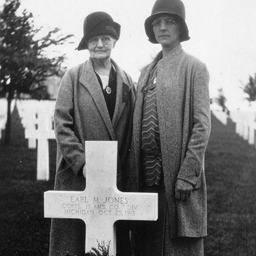 Gold Star mother Mrs B.F. Jones at her son Earl's grave in France
