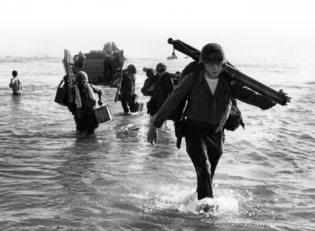 Marines come ashore near Da Nang Marines come ashore near Da Nang Air Base on March 8, 1965. Vietnamese officials only learned of plans to introduce American ground troops as 3,500 Marines were wading onto its shores. (National Archives, RG 127)