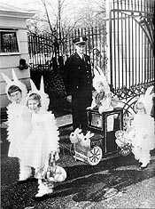 Children dressed as bunnies with cart