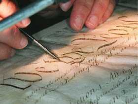 close-up of conservator working on Constitution