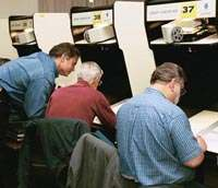 Photo of researchers at microfilm readers