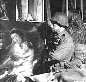 Pfc. Tony Baea looks at Rubens painting