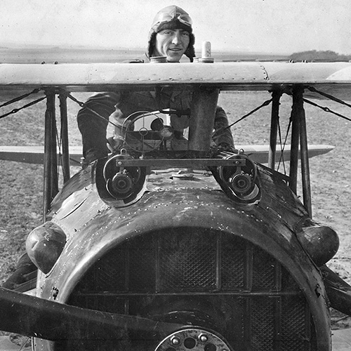 Eddie Rickenbacker standing up in his Spad plane, France, 1918