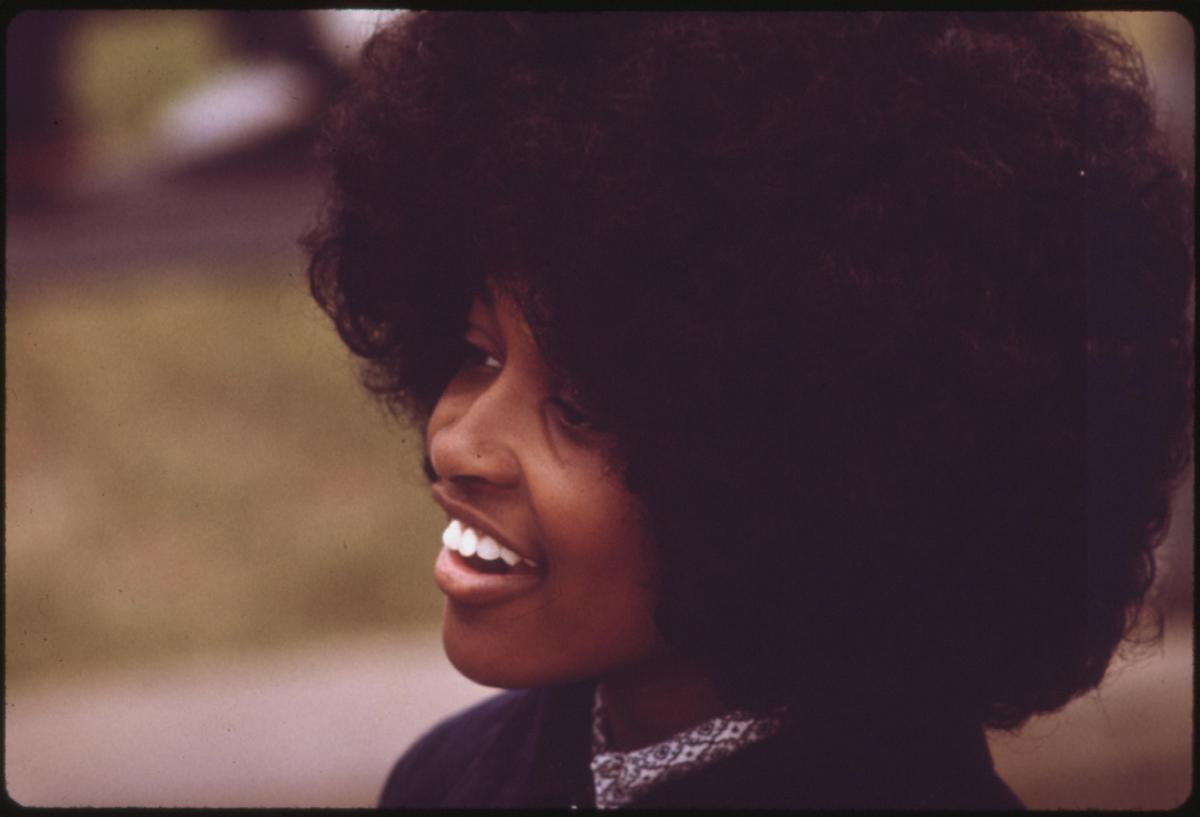 African American woman with an afro smiling
