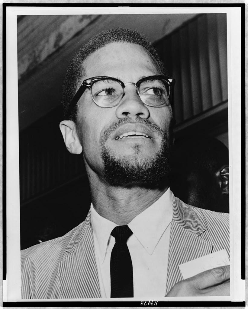 Malcolm X, head-and-shoulders portrait, facing right.