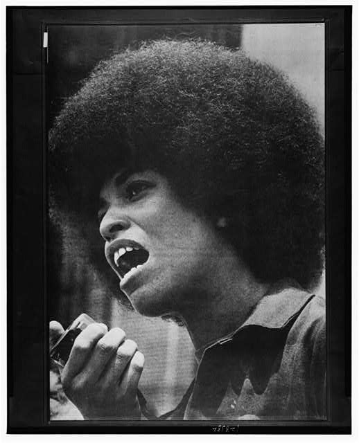 Angela Davis with speaker in her hand