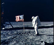 Aldrin posing by flag on moon's surface