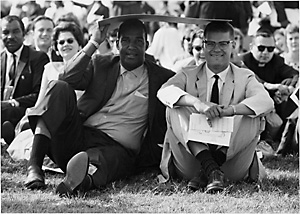 Sitting in sun during march on Washington, 1963