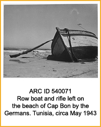 National Archives Identifier 540071 Row boat and rifle left on the beach of Cap Bon by the Germans. Tunisia, circa May 1943., 1943 - 1944
