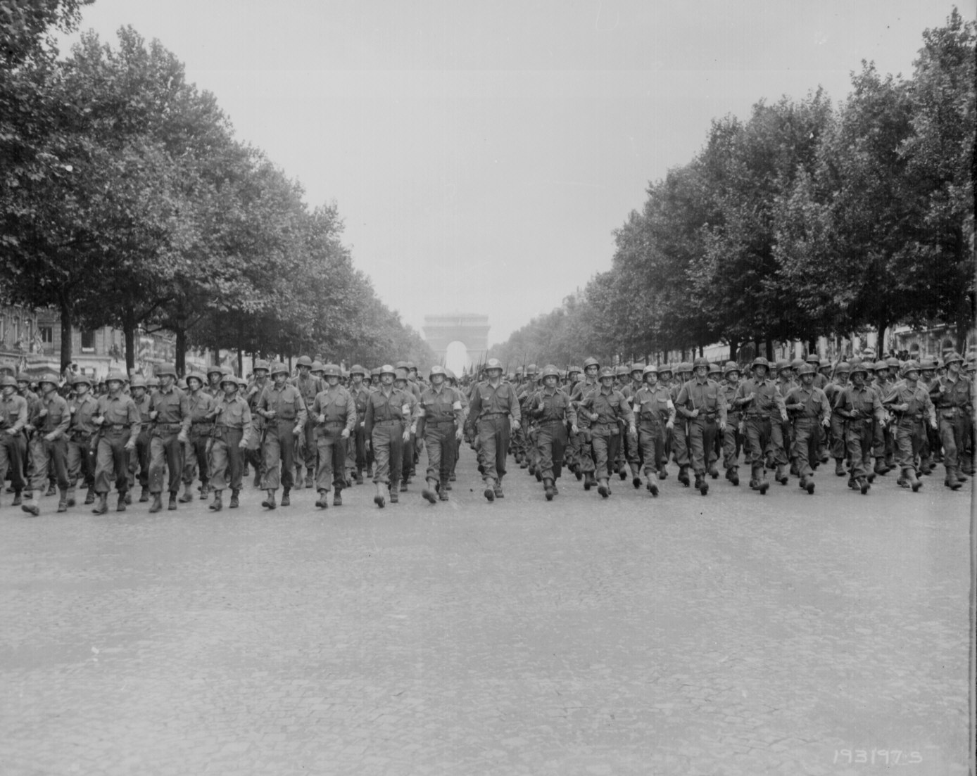 "American troops of the 28th Infantry Division march down the Champs Elysees, Paris, in the ""Victory"" Parade. Poinsett, August 29, 1944."