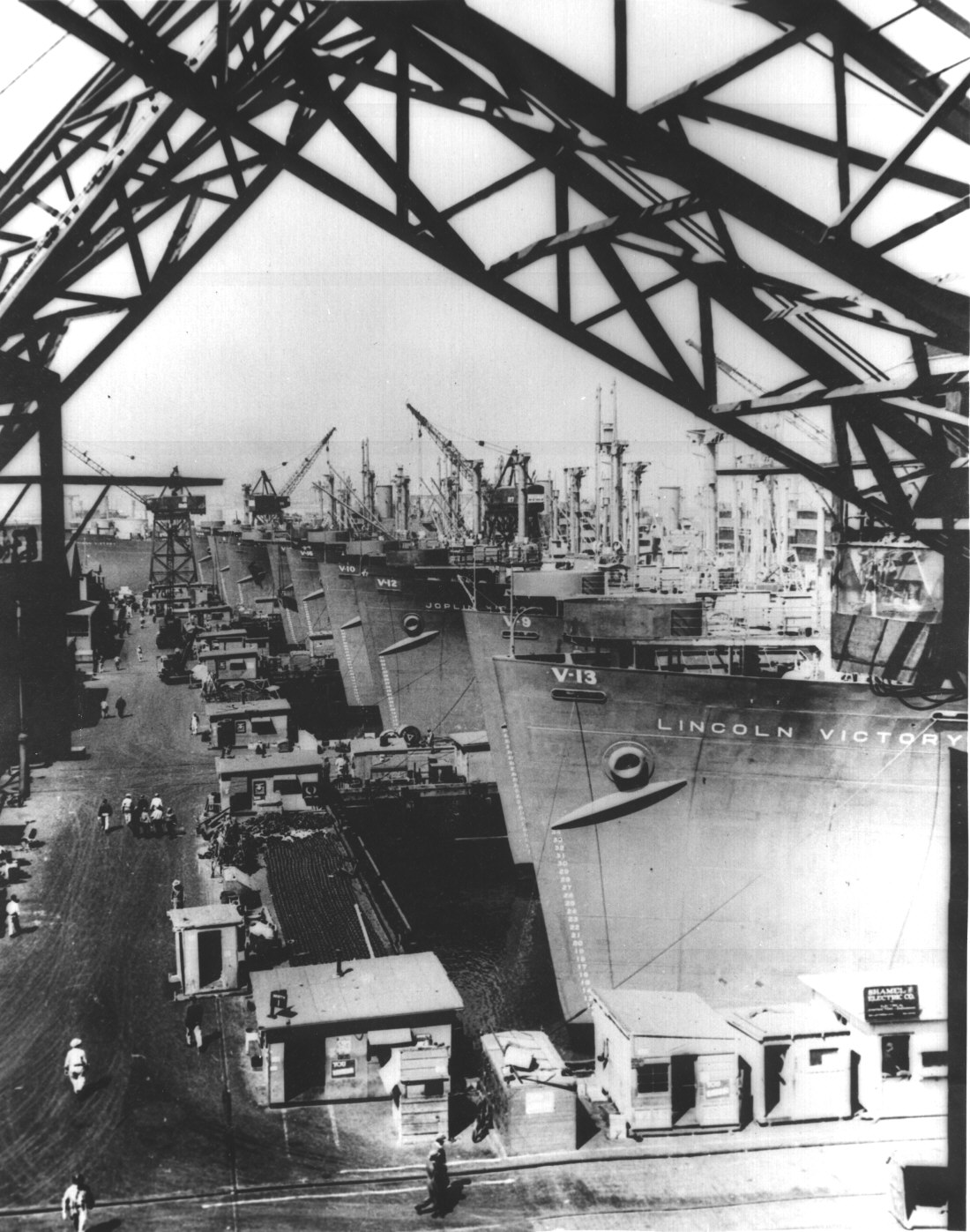 victory cargo ships are lined up at a u s