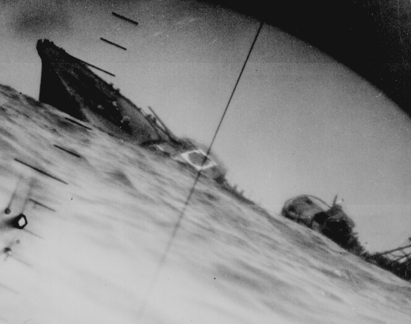 torpedoed japanese destroyer photographed through periscope of uss wahoo or uss nautilus